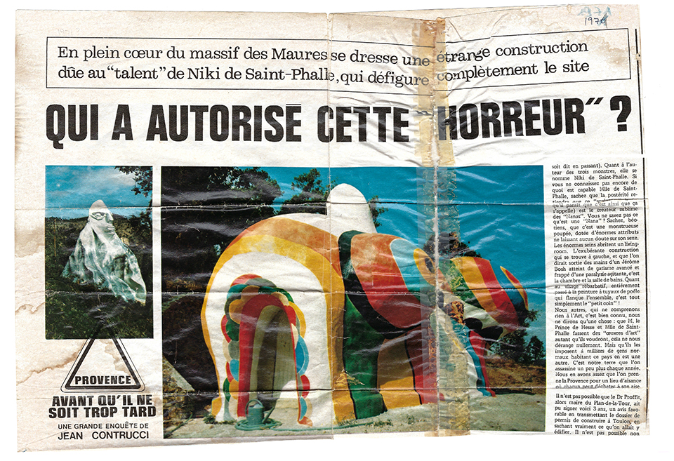 "newspaper article in French asks ""Who authorized this horror?"" Two images in color of the sculptural houses are printed."