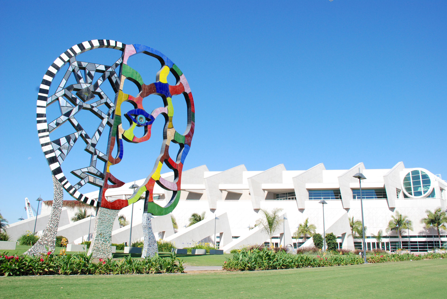 """The large colorful sculpture titles """"Coming Together"""" stands on the South end of the Convention Center in San Diego, California."""